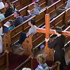 BRYAN EATON/Staff Photo. Holy Family and Star of the Sea Teens presented The Way of the Cross for Good Friday.