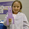JIM VAIKNORAS/Staff photo Clare Stratner, 7,from the River Valley Charter School demonstrates a green toy she make at the Green Expo at the Nock Middle School in Newburyport Thursday night.