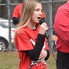 BRYAN EATON/Staff photo. Troy Marden's sister, Ellie, sings the National Anthem.