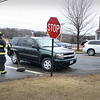 BRYAN EATON/Staff Photo. One woman was transported to the hospital in this two-car collision at Fern Avenue and Market Street in Amesbury just before 9:00 a.m. on Wednesday morning. Firefighters used the jaws of life to pry open the door.