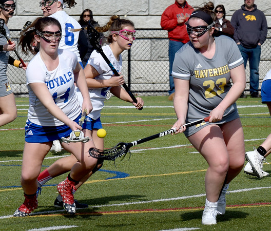 BRYAN EATON/Staff Photo. Georgetown's Brooke O'Donnell, left, and Haverhill's #23 go for the loose ball.