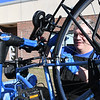 JIM VAIKNORAS/Staff photo Dave Ricjie of Peddlin Fools in Plastow fixes bikes at the Green Expo at the Nock Middle School in Newburyport Thursday night.