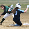 JIM VAIKNORAS/Staff photo Pentucket's Caitlin Kutcher swings the tag as Triton's Molly Kimball steals 2nd at Triton Friday.