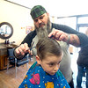 JIM VAIKNORAS/Staff photo Seamus McLachlan, 5, of Newburyport gets his hair cut by  Lowell Oliver at The Inn Street Barbershop in Newburyport Friday afternoon.