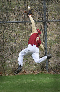 BRYAN EATON/Staff Photo. Newburyport left fielder Ryan Archer makes a difficult catch to get a Triton player out.
