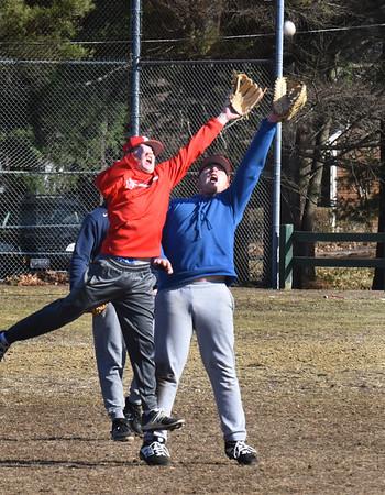 BRYAN EATON/Staff Photo. Amesbury High baseball players grab a popup in practice.