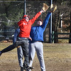 BRYAN EATON/Staff Photo. Amesbury High baseball players grab a popup in practice.