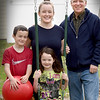 BRYAN EATON/Staff Photo. John Leary with his daughter Emily Webber, and her children Jackson, 8, and Colleen, 5.