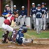 BRYAN EATON/Staff Photo. Triton's Cameron Gilroy is called safe at home plate.