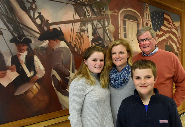 BRYAN EATON/Staff Photo. Christen Page, center, with daughter Sophie, son, Matthew, 11, and dad, former Newburyport mayor, John Moak.