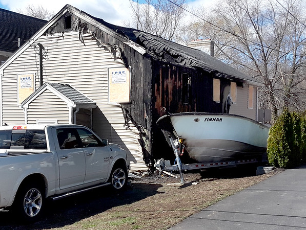 BRYAN EATON/Staff photo. This building at 9 South Pond Street in Newbury was damaged by fire early Tuesday morning.