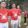 BRYAN EATON/Staff photo. Amesbury baseball players from left, Derek Doherty, Logan Burrill and Blake Bennet stand during the National Anthem sung by Troy Marden's sister, Ellie, right with Athletic Director Glen Guerin.