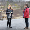 BRYAN EATON/Staff Photo. Beacon Street neighbors Dottie Titcomb, left, and Kathy Kodwyck are unhapping with the disruption of the building of 100 housing units at Bailey's Pond in Amesbury. They the building of retaining walls have contributed to cracks in their homes foundations.