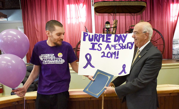 BRYAN EATON/Staff photo. Amesbury Mayor Ken Gray awarded Seth Willey with a proclamation for Purple Day to raise awareness of epilepsy.