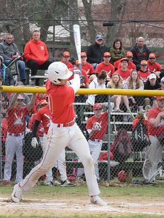 BRYAN EATON/Staff photo. Logan Burrill pops the ball for to the outfield but was caught by the Masco centerfielder.