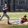 BRYAN EATON/Staff Photo. Kyle Therrien slides into second base on a steal.