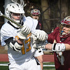BRYAN EATON/Staff Photo. Newburyport's # 29 puts pressure on Favuzza.