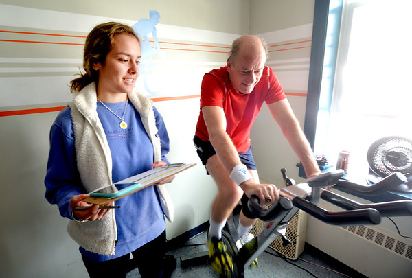 "JIM VAIKNORAS/Staff photo Ava Grady, 17, takes stat on Larry Thode at the YWCA 10th Annual ""Tri for the YW"". The event featuring a 10-minute swim in the indoor lap pool, a 25-minute cycle on a spin bike, and a 1.5 mile run outdoors on the Clipper City Rail Trail."
