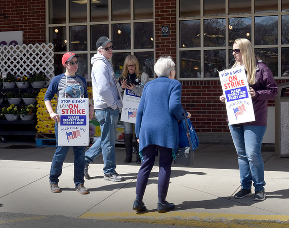 BRYAN EATON/Staff Photo. Striking Stop and Shop employees tell a customer the store in Amesbury is closed.