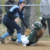 JIM VAIKNORAS/Staff photo Pentucket's Caitlin Kutcher is tagged out at 3rd by  Triton's Colleen McCarthy at Triton Friday.