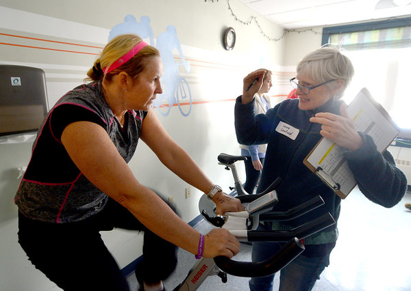 """JIM VAIKNORAS/Staff photo Laura Schofield gives some encouragement to Kim Desrosiers at the YWCA 10th Annual """"Tri for the YW"""". The event featuring a 10-minute swim in the indoor lap pool, a 25-minute cycle on a spin bike, and a 1.5 mile run outdoors on the Clipper City Rail Trail."""
