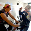 "JIM VAIKNORAS/Staff photo Laura Schofield gives some encouragement to Kim Desrosiers at the YWCA 10th Annual ""Tri for the YW"". The event featuring a 10-minute swim in the indoor lap pool, a 25-minute cycle on a spin bike, and a 1.5 mile run outdoors on the Clipper City Rail Trail."