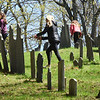 BRYAN EATON/Staff Photo. The seventh-graders at the Nock Middle School in Newburyport held a community service week, and cleaning, repairing headstones and general cleanup of the N