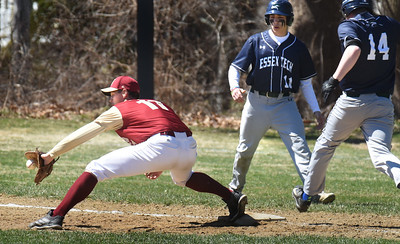 BRYAN EATON/Staff Photo. Newburyport first baseman Casey McLaren completes the double play on a throw from shortstop Ryan Archie.