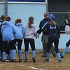 JIM VAIKNORAS/Staff photo Teammate greet Mia Berardino at home plate after she homered against Pentucket Friday at Triton in Byfield.