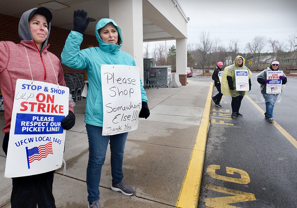 BRYAN EATON/Staff Photo. Amanda DeVeau, bakery manager and strike captain, left, and Maria Montello, florist manager, stike captain and union steward, and their coworkers continue their strike at the Amesbury Stop and Shop.