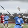 BRYAN EATON/Staff photo. Triton's Kyle Bouley tries to block a throw by Masconomet's #20.