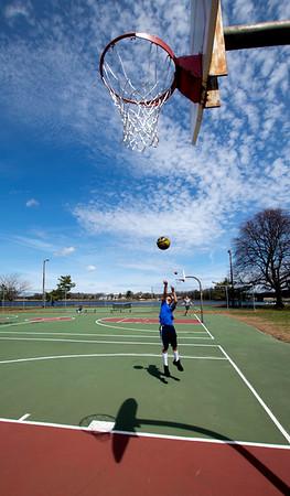 JIM VAIKNORAS/Staff photo Dwayne Blake Jr. 10 , of Salisbury cast a shadow in the sunshine Saturday as he shoots around in Cashman Park in Newburyport.