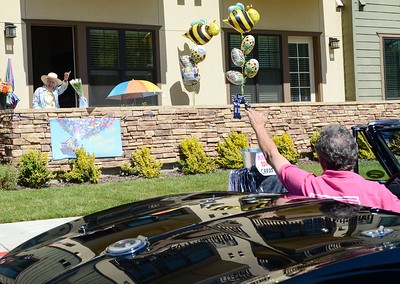 Faye McGowan waves to Bob Fitzgerald during her drive by 100th birthday party Friday in Chico. (Matt Bates -- Enterprise-Record)