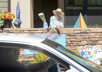 Faye McGowan smiles as she speaks with attendees of her drive by 100th birthday party Friday in Chico. (Matt Bates -- Enterprise-Record)