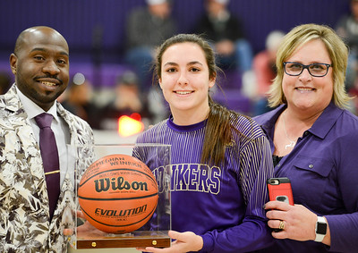 Willows' Meghan Weinrich is honoroed for becoming the second all-time leading scorer in Northern Section girls basketball history with assistant coach Calvin Johnson (left) and head coach Carol Martin (right). Weinrich was named the Northern Section MVP on Thursday. (Matt Bates -- Enterprise-Record file)