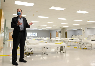 Enloe Medical Center President and CEO Mike Wiltermood speaks during a media tour Wednesday in Chico of the hospital's Rehabilitation Center which has been converted to a filed medical station. (Matt Bates -- Enterprise-Record)