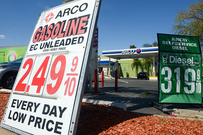 Signs show gas as low as $2.49 a gallon Tuesday at the downtown Arco in Chico. (Matt Bates -- Enterprise-Record)