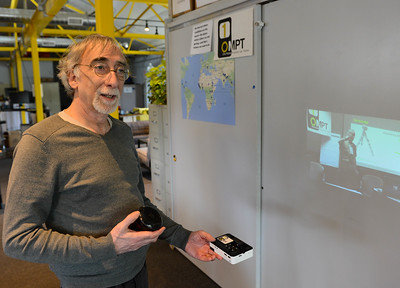 One Mobile Projector per Trainer director Matt York talks about his portable projectors at his office Wednesday in Chico. (Matt Bates -- Enterprise-Record)