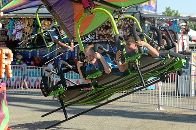 Mason Ellgood and Leonardo Villicana fly through the air on a carnival ride at the Glenn County Fair on May 18, 2018. (Carin Dorghalli -- Enterprise-Record file)