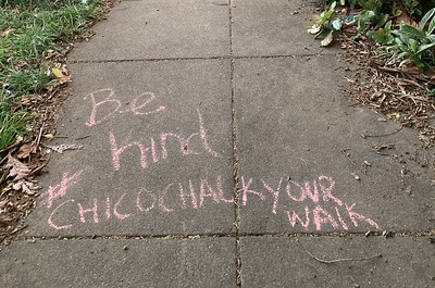 """Be kind #ChicoChalkYourWalk"" is written in pink chalk on a sidewalk on Mulberry Street in Chico. (Camille von Kaenel -- Enterprise-Record)"