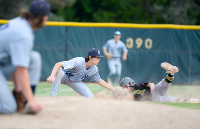 Pleasant Valley's Jacob Flener tags out Red Bluff's Tyler Schorovsky during the Viking's game against the Spartans on May 22, 2019, at Butte College in Butte Valley. (Matt Bates -- Enterprise-Record)