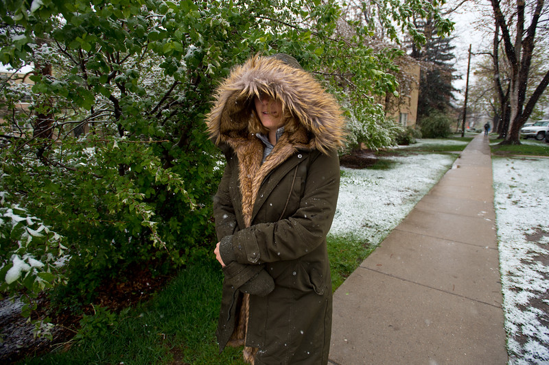 "Madeleine Croke, a CU Boulder student, wears a heavy fur coat to keep herself warm during the storm on Friday.<br /> More photos:  <a href=""http://www.dailycamera.com"">http://www.dailycamera.com</a><br /> Autumn Parry/Staff Photographer<br /> April 29, 2016"