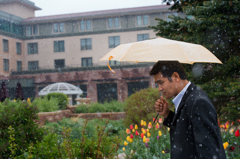 "Pemba Sherpa uses an umbrella to shield himself from the storm while walking to work at Sherpa's Restaurant and Bar in Boulder on Friday. <br /> More photos:  <a href=""http://www.dailycamera.com"">http://www.dailycamera.com</a><br /> Autumn Parry/Staff Photographer<br /> April 29, 2016"