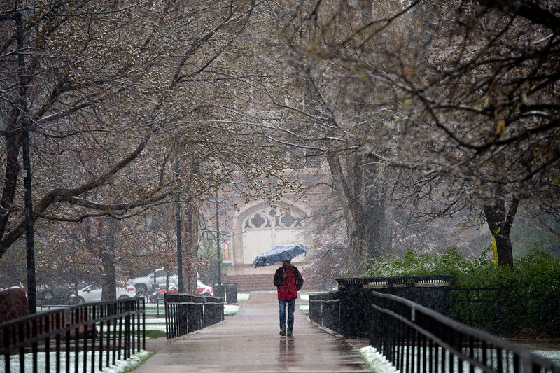 "A student passes through Norlin Quad, using an umbrella to shield himself from the storm, at CU Boulder on Friday.<br /> More photos:  <a href=""http://www.dailycamera.com"">http://www.dailycamera.com</a><br /> Autumn Parry/Staff Photographer<br /> April 29, 2016"