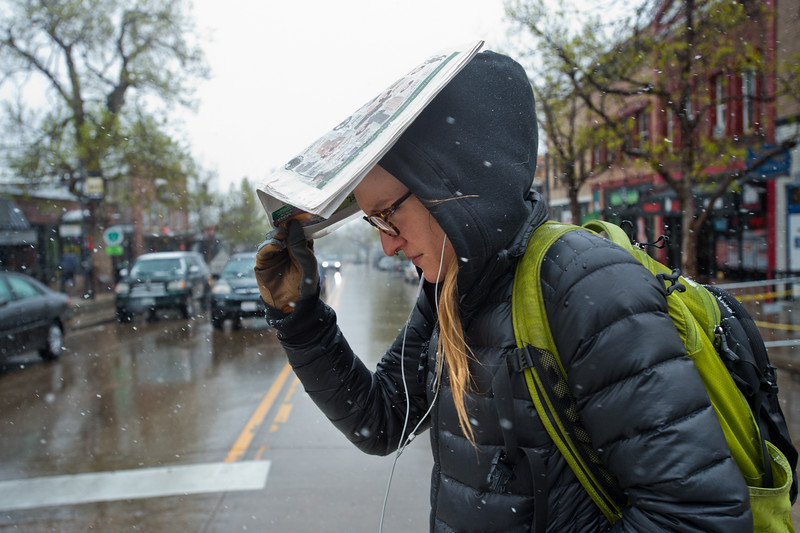 "Molly Day, a student at CU Boulder, uses a paper to keep herself dry during the snowstorm as she leaves campus on Friday.<br /> More photos:  <a href=""http://www.dailycamera.com"">http://www.dailycamera.com</a><br /> Autumn Parry/Staff Photographer<br /> April 29, 2016"