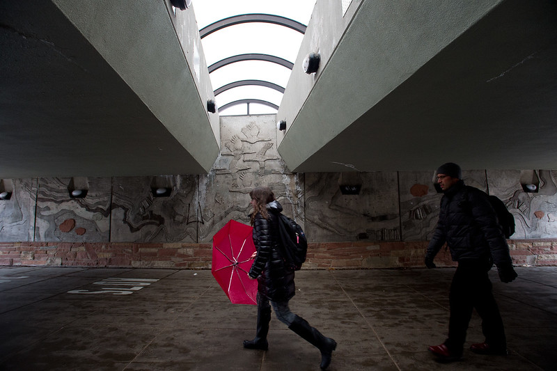 "Students pass under the bridge at CU Boulder during the storm on Friday. <br /> More photos:  <a href=""http://www.dailycamera.com"">http://www.dailycamera.com</a><br /> Autumn Parry/Staff Photographer<br /> April 29, 2016"