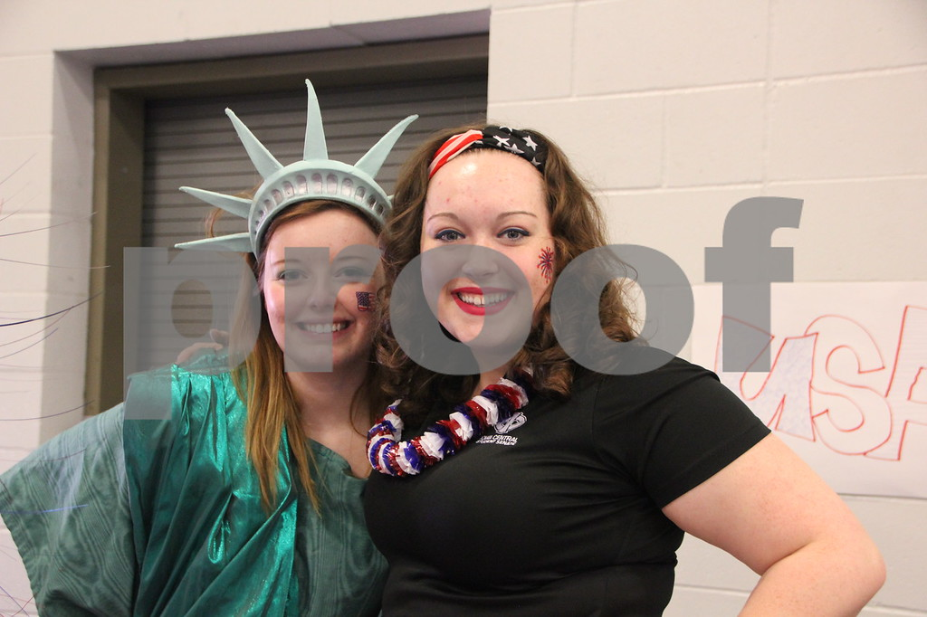 The Festival of Nations was held at the Iowa Central Community College campus in the Career Education building in Fort Dodge. The event took place on Sunday, April 3, 2016. Pictured left to right is: Melanie Lambert and Kait Daisy, who had a booth at the event, for the college Student Government. Almost every nation was represented with booths, food, dancing, or demonstrations of various skills. Present were also a few who were dressed in national costumes as well as seen here.