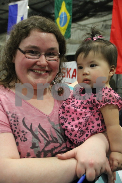 The Festival of Nations was held at the Iowa Central Community College campus in the Career Education building in Fort Dodge. The event took place on Sunday, April 3, 2016. Shown here is (left to right): Jasmine Picket and her daughter, Alena Picket, from Eagle Grove, who attended the event. Almost every nation was represented with booths, food, dancing, or demonstrations of various skills. Present were also a few who were dressed in national costumes as well