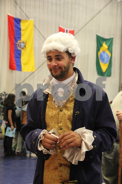 The Festival of Nations was held at the Iowa Central Community College campus in the Career Education building in Fort Dodge. The event took place on Sunday, April 3, 2016. Seen here is: Konrad Powell who had a booth for the Student Government at the event, dressed in costume . Almost every nation was represented with booths, food, dancing, or demonstrations of various skills. Present were also a few who were dressed in national costumes as well as seen here.