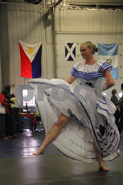The Festival of Nations was held at the Iowa Central Community College campus in the Career Education building in Fort Dodge. The event took place on Sunday, April 3, 2016. Seen here is: Leah Applebee demonstrating  one of the national dances at the event, dressed in costume . Almost every nation was represented with booths, food, dancing, or demonstrations of various skills. Present were also a few who were dressed in national costumes as well as seen here.